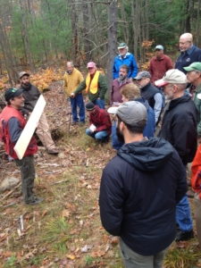 Forester Charlie Moreno shows a milled board to woodworkers attending the Forest to Workbench workshop